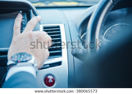 Hand turning air from air ventilation in the car #380065573