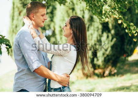 full of love stylish beautiful young  couple on background of ground #380094709
