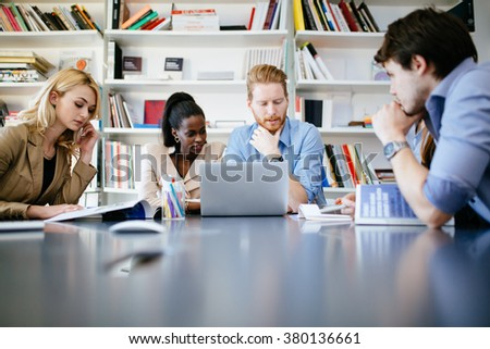 Businesspeople working in clean white modern office #380136661