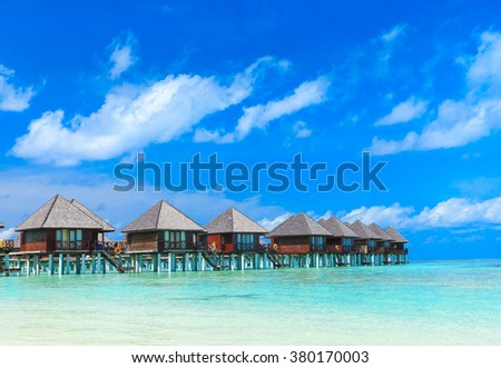 beach with water bungalows at Maldives #380170003
