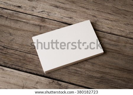 Business card blank on wood background