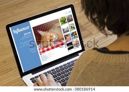 marketing influencer concept: influencer website on a laptop screen. Screen graphics are made up.