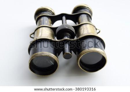 Vintage binoculars on a light background  #380193316