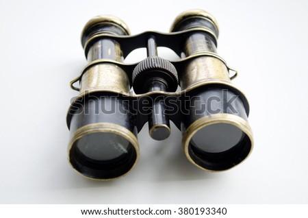 Vintage binoculars on a light background  #380193340