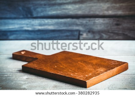 Toned photo. Color tone tuned. Background with cutting board on wooden table #380282935
