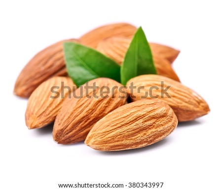 Almonds nuts with leaves close up on white background .  #380343997