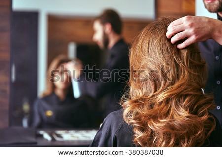 Women's haircut. hairdresser, beauty salon Royalty-Free Stock Photo #380387038