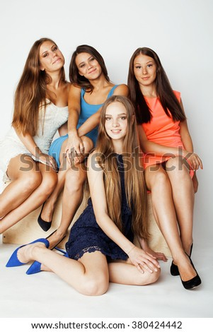 many girlfriends hugging celebration on white background, smiling talking chat, girl next door close up wondering sweety group #380424442