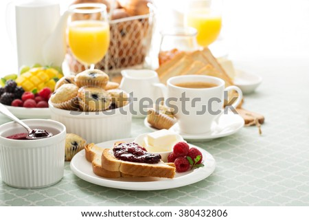 Fresh and bright continental breakfast table with jam on toast #380432806