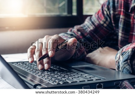 Closeup hand are using laptops