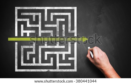 hand drawing a shortcut to a maze on a chalkboard Royalty-Free Stock Photo #380441044
