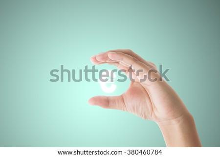 businessman hand holding  euro  sign on blue background #380460784