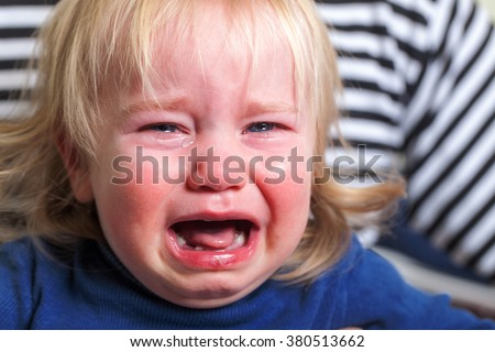 crying tears toddler with blond hairstyle #380513662