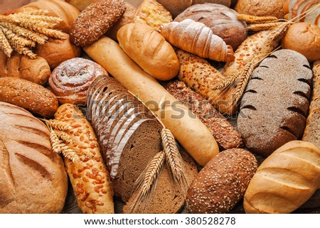 Fresh fragrant bread on the table. Food concept Royalty-Free Stock Photo #380528278