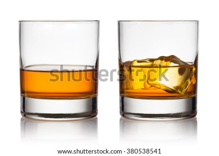 Glass of scotch whiskey and ice on a white background #380538541