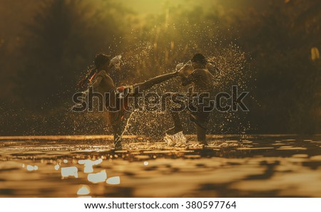 The fighter tying tape around his hand preparing to fight,Thai boxing at the river,Boxing fighters trainning outdoor,Muay Thai Royalty-Free Stock Photo #380597764