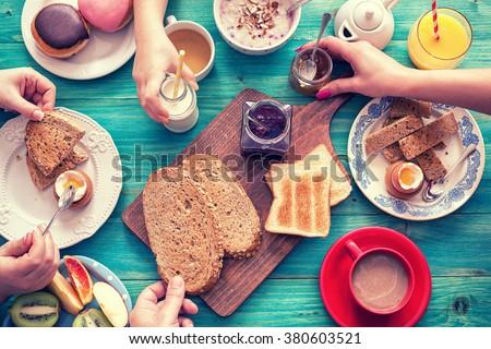 Young Happy Family Having Breakfast #380603521