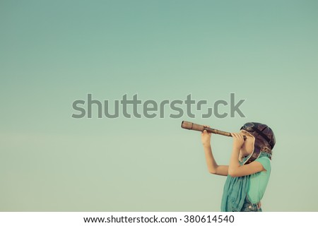 Happy kid playing outdoors. Travel and adventure concept Royalty-Free Stock Photo #380614540