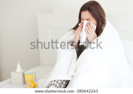 Young woman sick in bed #380642263