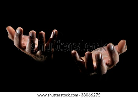 Human hands isolated in a black background #38066275