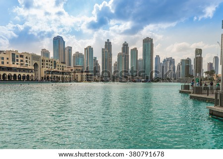 Dubai, United Arab Emirates - Dec 2, 2014: Panorama view of the Comercial Center Souk Al Bahar, near the highest building in the world, burj Khalifa with a pond were worlds largest fountain show is #380791678