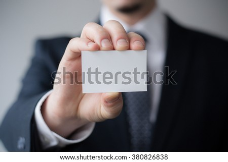 Hand holding business card with the message blank #380826838