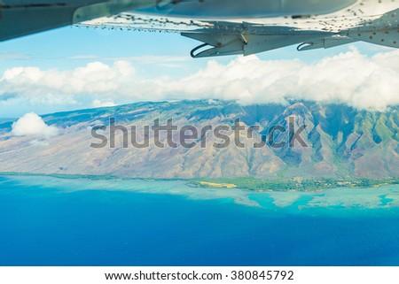 Stunning aerial view of na pali coast at Kauai island, Hawaii from an airplane  #380845792