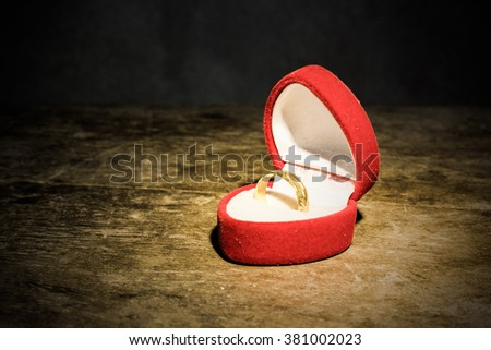 still life with golden ring in box