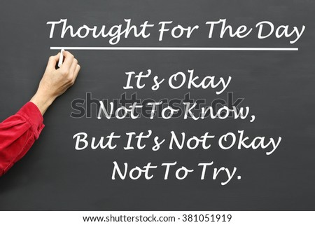 Inspirational Thought For The Day message of It's Okay Not To Know, But It's Not Okay Not To Try written on a School Blackboard by the teacher. #381051919