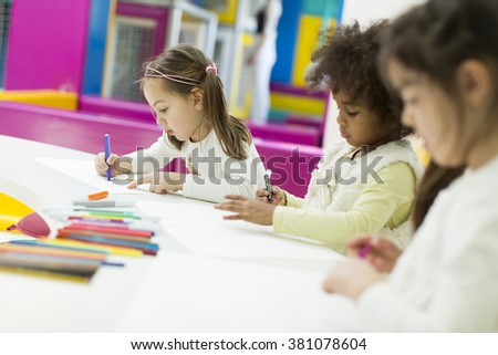 Multiracial children drawing in the playroom #381078604