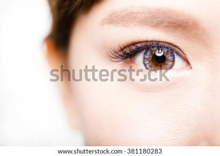 Closeup shot of young beautiful woman eyes  #381180283