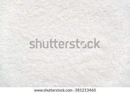 White delicate soft  background of plush fabric Royalty-Free Stock Photo #381213460