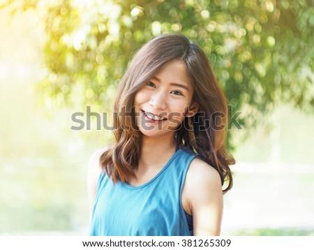 Woman smile at the garden #381265309