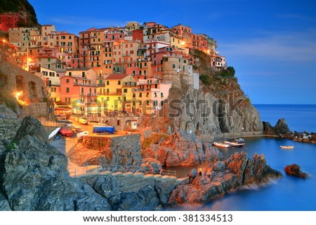 Old buildings of the village and harbor of Manarola at night, Cinque Terre, Italy #381334513