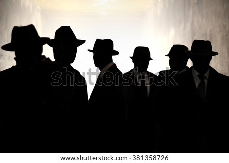 Men Fedora Hats silhouette. Security, Privacy, Surveillance Concept. #381358726