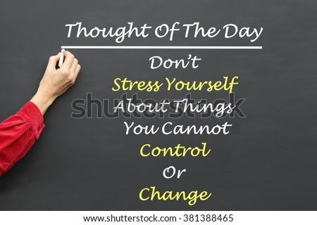 Inspirational Thought For The Day message of Don't Stress Yourself About Things You Cannot Control Or Change written on a School Blackboard by the teacher. #381388465