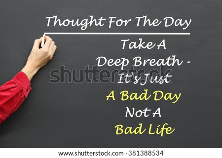 Inspirational Thought For The Day message of  Take A Deep Breath - It's Just A Bad Day Not A Bad Life written on a School Blackboard by the teacher. #381388534