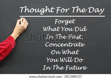 Inspirational Thought For The Day message of Forget What You Did In The Past, Concentrate On What You Will Do In The Future written on a School Blackboard by the teacher. #381388537