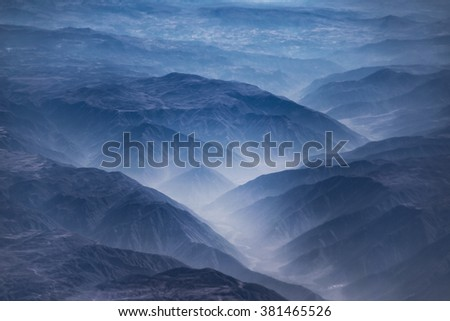 Aerial view from window plane of Andes mountains