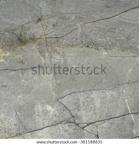 Serpertine marble with cracks, natural stone texture, grey rock #381588835