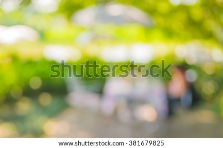 image of blur outdoor restaurant on day time with green tree bokeh for background usage . #381679825