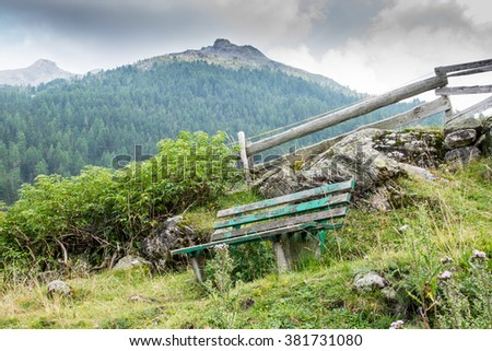 old bench in the mountains #381731080