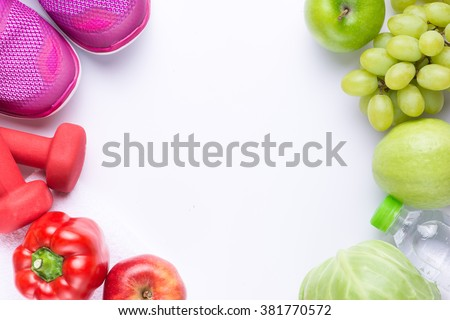 Resolutions eat healthy, lose weight and join gym, fresh fruits, dumbbells for fitness and tape measure, healthy lifestyle Royalty-Free Stock Photo #381770572