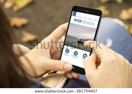 responsive fluid design concept: woman holding a 3d generated smartphone with web design site on the screen. Graphics on screen are made up.