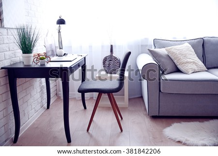 Workplace a home with laptop and table on window background #381842206