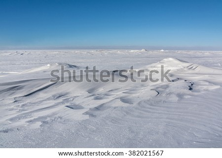 Snow drifts soften the jagged ice at the edge of Lake Superior near Meyers Beach, Wisconsin. #382021567