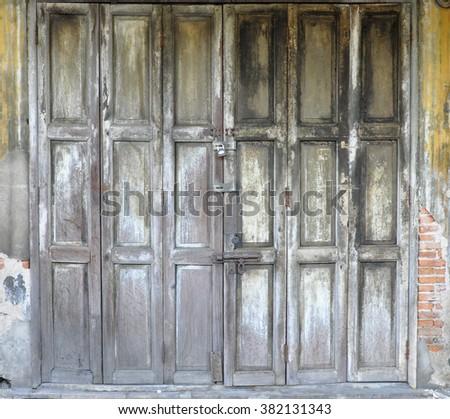 Wooden door of old house. #382131343