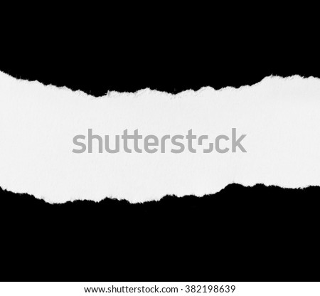 piece of ripped white paper on black background #382198639