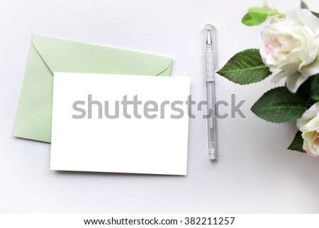 Mockup with envelope, blank card and dry roses.