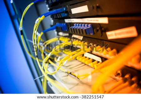 fiber optic with servers in a technology data center . #382251547